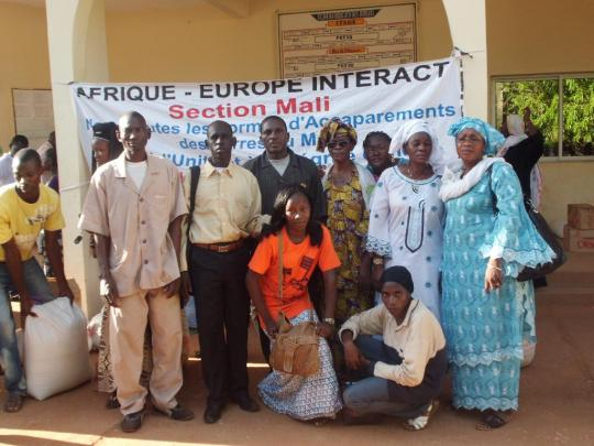 Activists of the malian section of Afrique-Europe-Interact during the handover of the food donation in Segou